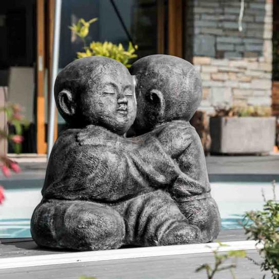 Grey embracing Shaolin monk statue