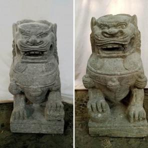 Two volcanic rock guardian lion statues 65 cm