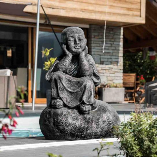 Pensive grey weathered-finish Shaolin monk statue